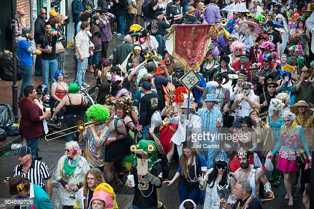 costumes and music celebrating mardi gras - new orleans - mardi gras fun in new orleans stock photos and pictures