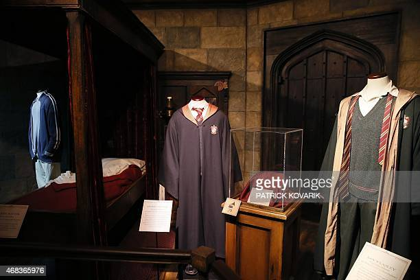 Costumes are on display during an exhibition on the literary characters of the Harry Potter novels at the Cite Du Cinema on April 2 in SaintDenis...