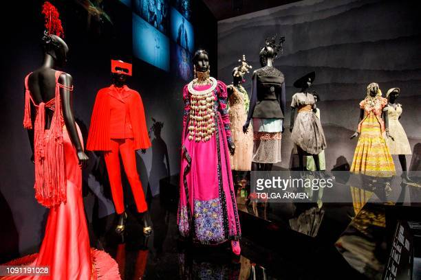 Costumes by Dior designers are on show at 'Christian Dior Designer of Dreams' exhibition at the Victoria and Albert museum in London on January 30...