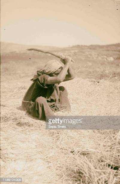 Costumes characters etc Woman threshing with flail 1900