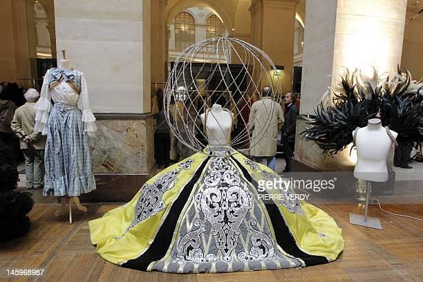 Costumes from the Folies Bergere are displayed at the Palais de la Bourse as part of the Ventes de folie auction in Paris on June 8 2012 The auction...