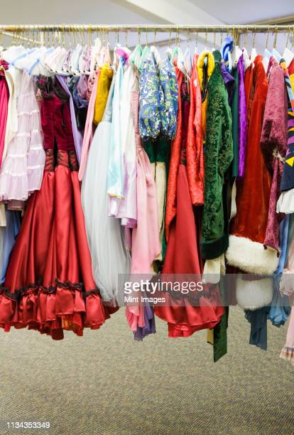 costumes on a rack - stage costume stock pictures, royalty-free photos & images
