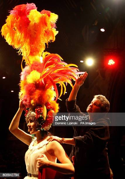 Costumier Annie Galbraith adjusts a 'Carmen Miranda' headdress originally worn by female impersonator Danny La Rue part of a collection of his 90...