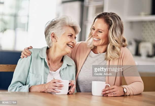 cosy chats over coffee - mother daughter stock photos and pictures