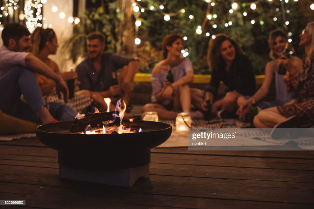 Cosy evening with friends : Stock Photo