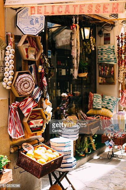 cosy traditional gourmet shop selling food and handmade art in palma de mallorca - palma majorca stock photos and pictures