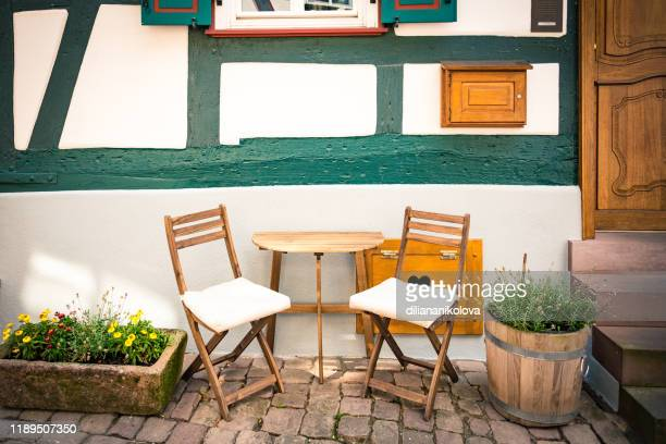 cosy wooden table chairs set front