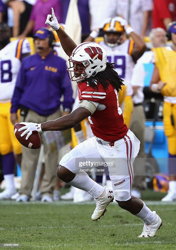 D'Cota Dixon #14 of the Wisconsin Badgers celebrates after intercepting a pass thrown by Brandon Harris #6 of the LSU Tigers (not pictured) during the fourth quarter at Lambeau Field on September 3, 2016 in Green Bay, Wisconsin.