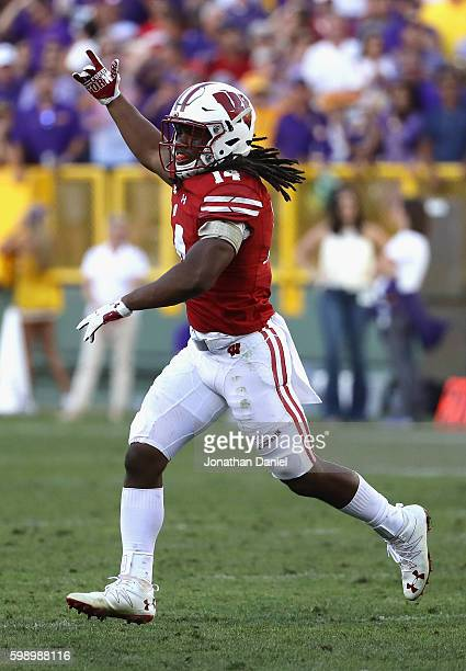 Cota Dixon of the Wisconsin Badgers celebrates after intercepting a pass thrown by Brandon Harris of the LSU Tigers during the fourth quarter at...