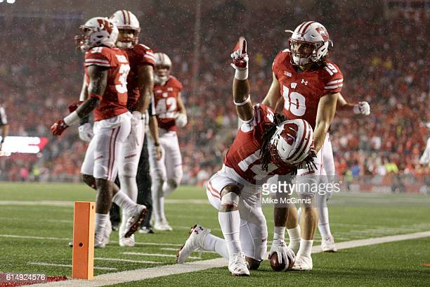 Cota Dixon of the Wisconsin Badgers celebrates after intercepting a pass in the end zone during the third quarter against the Ohio State Buckeyes at...