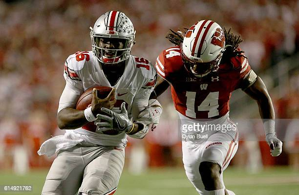 Cota Dixon of the Wisconsin Badgers chases after JT Barrett of the Ohio State Buckeyes in the first quarter at Camp Randall Stadium on October 15...