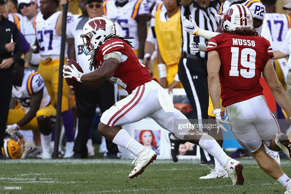 D'Cota Dixon #14 of the Wisconsin Badgers intercepts a pass thrown by Brandon Harris #6 of the LSU Tigers (not pictured) during the fourth quarter at Lambeau Field on September 3, 2016 in Green Bay, Wisconsin.