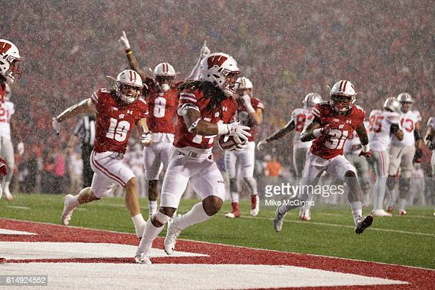 Cota Dixon of the Wisconsin Badgers intercepts the football in the end zone during the third quarter against the Ohio State Buckeyes at Camp Randall...