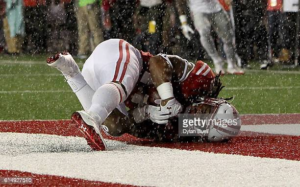 Cota Dixon of the Wisconsin Badgers makes an interception in the third quarter against the Ohio State Buckeyes at Camp Randall Stadium on October 15...
