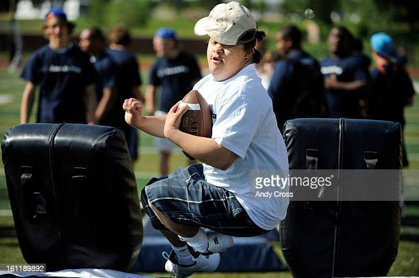 RANCH COTaylor Shelsta 20yearsold with Down Syndrome bashes through some pads during football drills at Valor Christian High School stadium in...