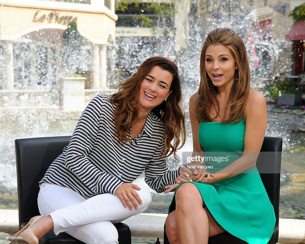 Cote De Pablo (L) and Maria Menounos visit 'Extra' at The Grove on April 23, 2013 in Los Angeles, California.