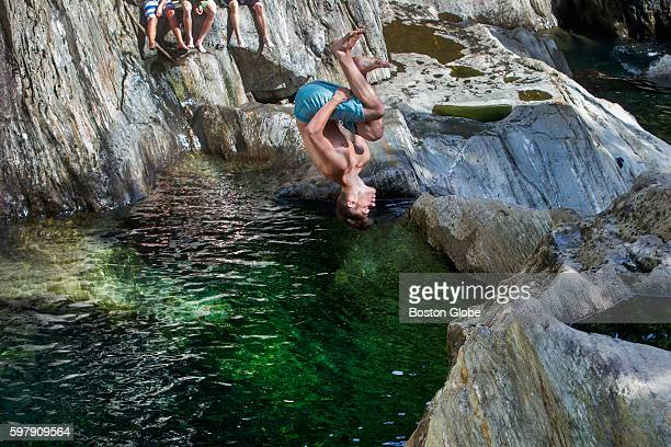 Cote Lacourse of Manchester NH flips into the formerly secret swimming hole at Warren Falls made up of a series of small cascading waterfalls...