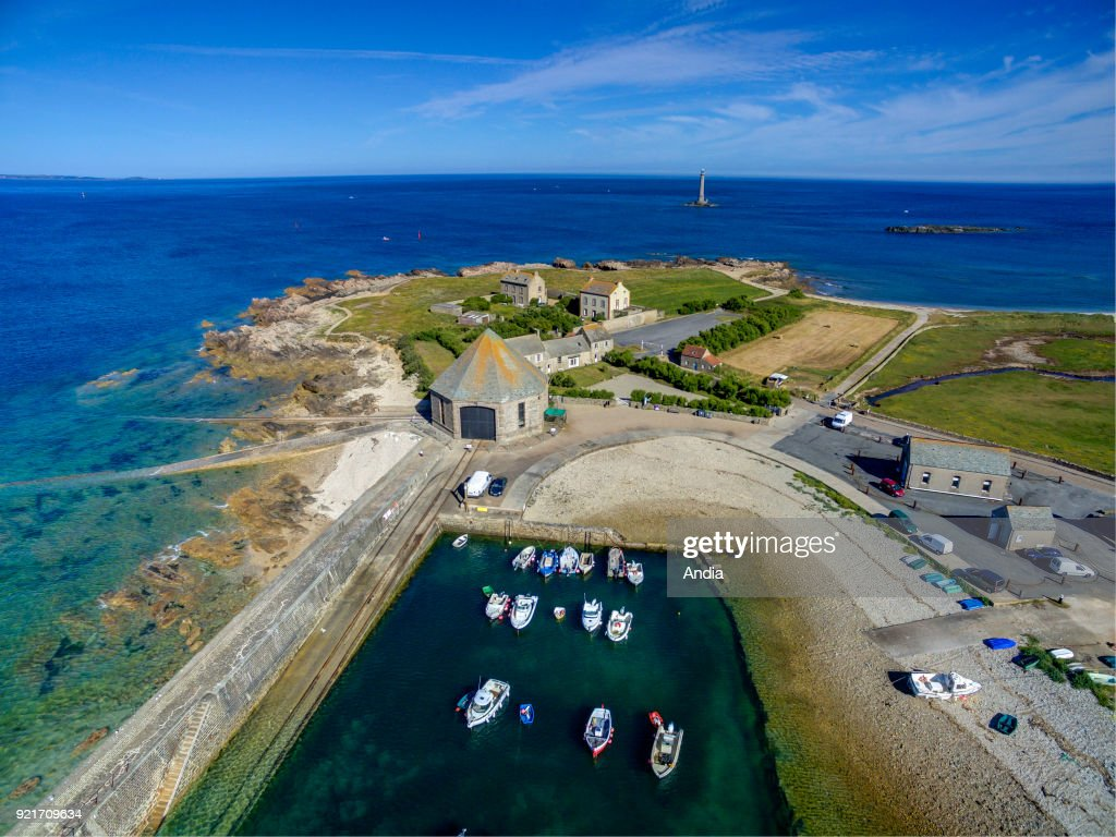 aerial view over the Lighthouse of Goury or Lighthouse of La Hague and the small fishing port of Goury, 'Cap de la Hague' headland, Cotentin Peninsula, along the Norman coast.