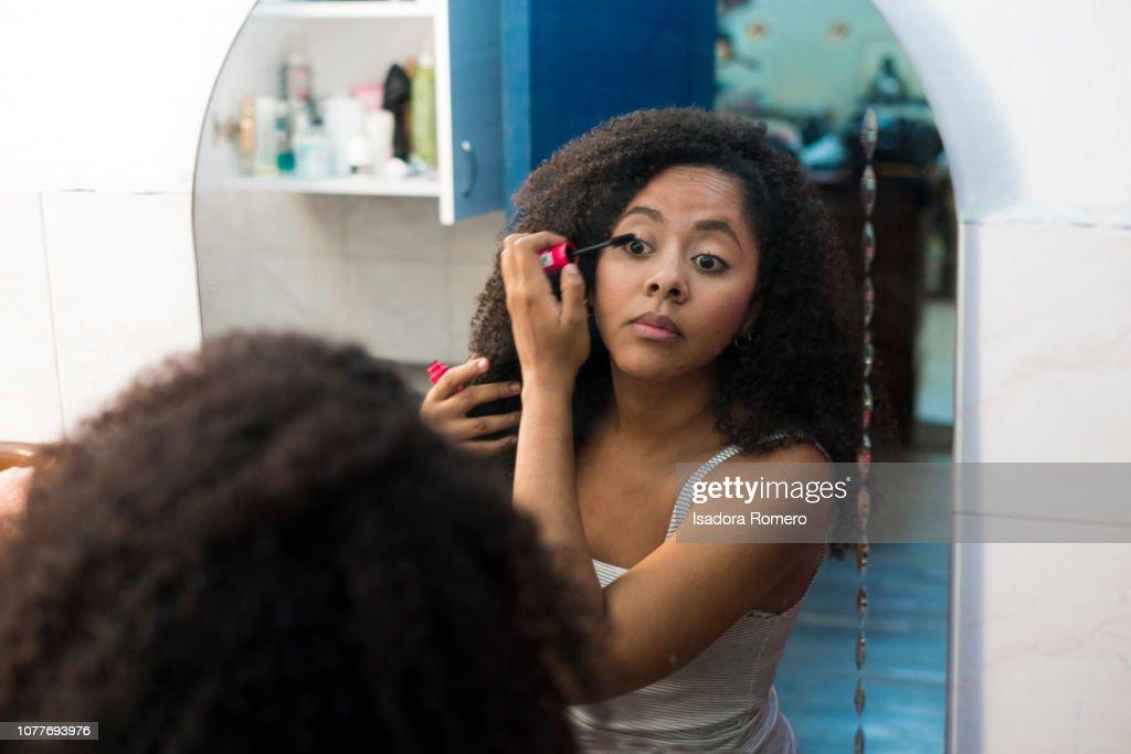 Woman getting ready in the bathroom