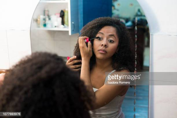 Woman getting ready in the bathroom
