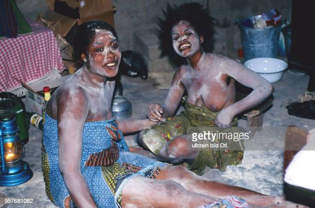 The vodu priestess Wekenou doing a healing ceremony for two girls followed by bad luck The two unlucky girls waiting for their healing