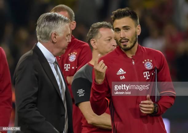 CoTrainer Davide Ancelotti spricht mit Cheftrainer Carlo Ancelotti waehrend dem DFL Supercup zwischen Borussia Dortmund gegen FC Bayern Muenchen am...