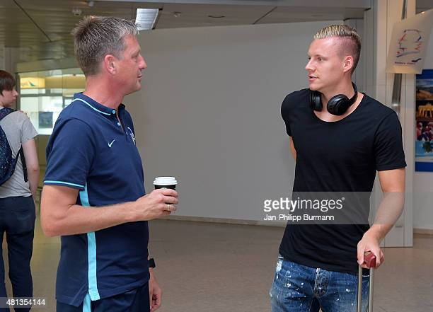 CoTrainer Rainer Widmayer of Hertha BSC talks with Bernd Leno of Bayer 04 Leverkusen during the arrival at Salzburg Airport of the trainingscamp in...