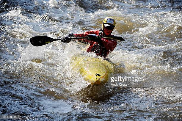 Travis Macy, from Evergreen Colorado, takes his kayak down the Gore River in Vail for the Down River Sprint at the 10th annual Teva Mountain Games in...