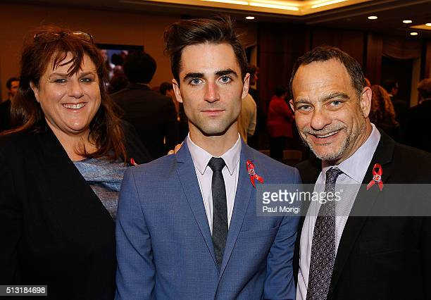 CoTrustees of the Elizabeth Taylor Trust Barbara Berkowitz and Quinn Tivey pose for a photo with Joel Goldman Managing Director of The Elizabeth...