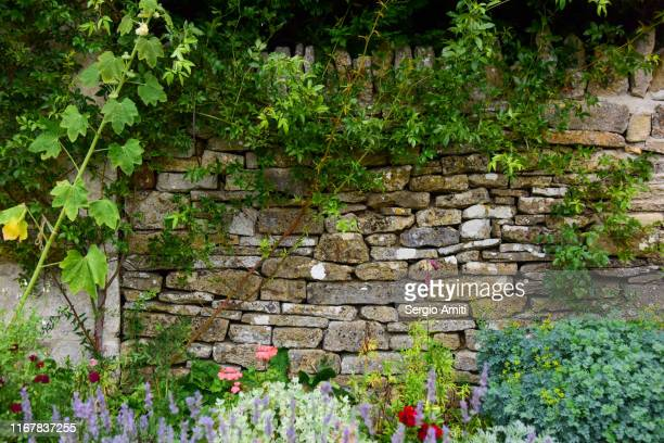 cotswolds dry stone wall - english culture stock pictures, royalty-free photos & images