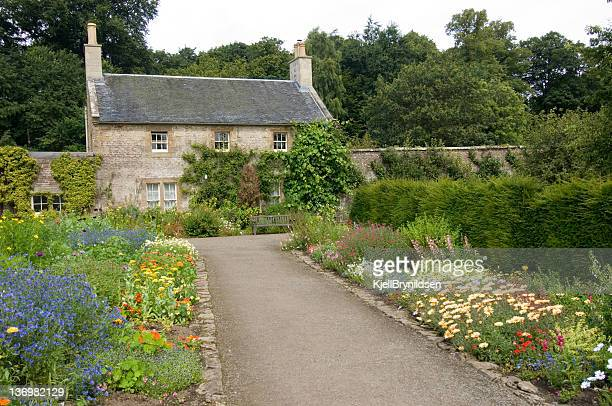 Cottage and flower bed