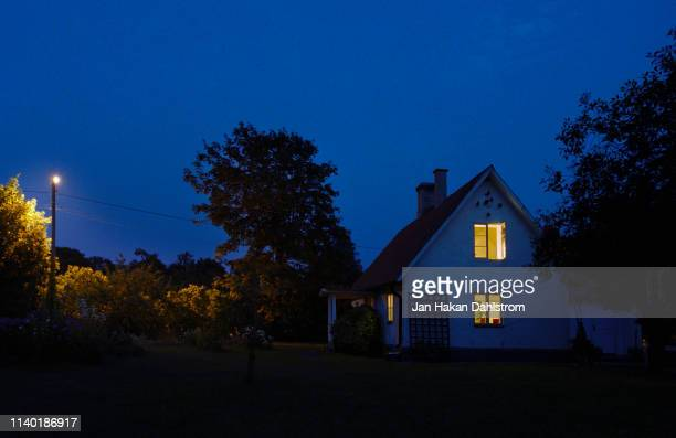 cottage and garden in summer night - gotland stock pictures, royalty-free photos & images