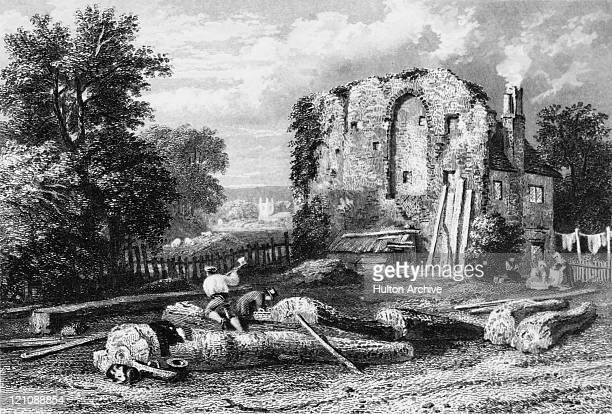 A cottage built in the ruins of Reading Abbey with St Peter's Church Caversham in the background circa 1855 An engraving by W Hackshell after William...