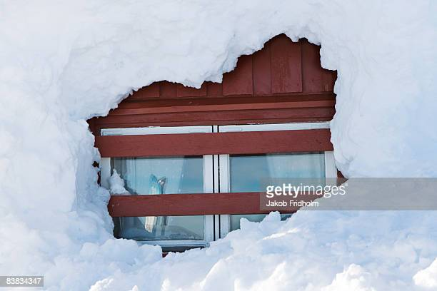 a cottage covered with snow sweden. - deep snow stock pictures, royalty-free photos & images