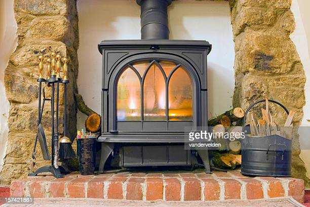 cottage fire - wood burning stove stock photos and pictures