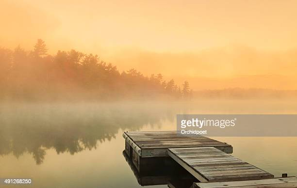 cottage foggy sunrise - lake stock pictures, royalty-free photos & images