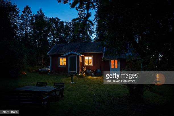 Cottage in forest in the evening