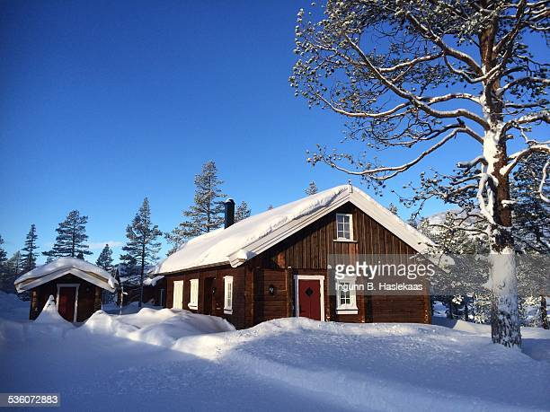 Cottage in the norwegian mountains Great winter day with lots of snow