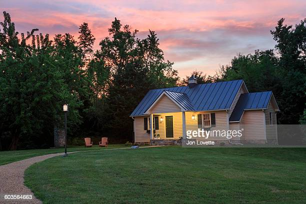 cottage on a hill - cottage exterior stock pictures, royalty-free photos & images