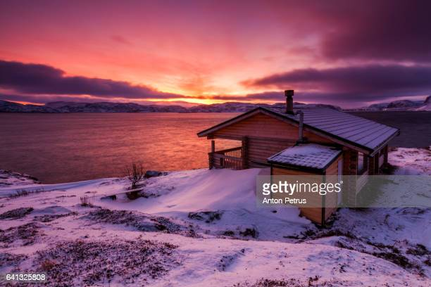 cottage on the shore of the arctic ocean at sunrise - anton petrus stock pictures, royalty-free photos & images