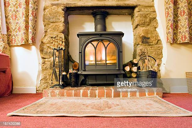cottage stove - wood burning stove stock photos and pictures