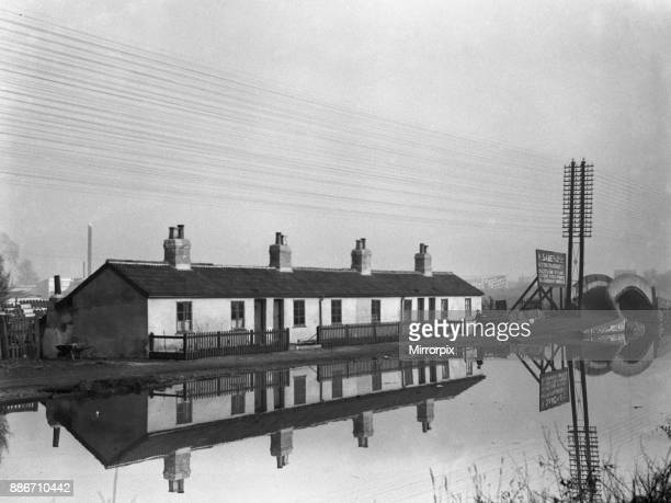 Cottages reflected in the Grand Union Canal near Uxbridge Circa 1934