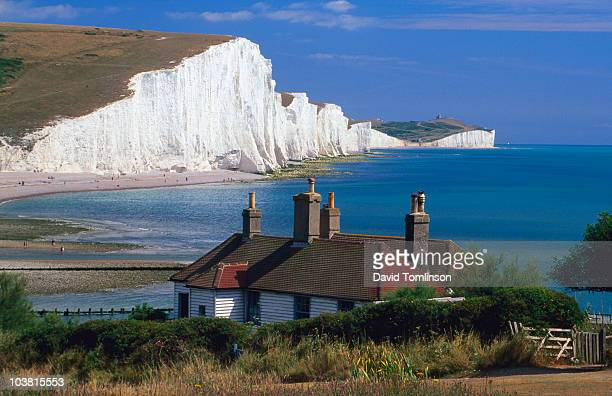 cottages with seven sisters cliffs in background. - east stock pictures, royalty-free photos & images