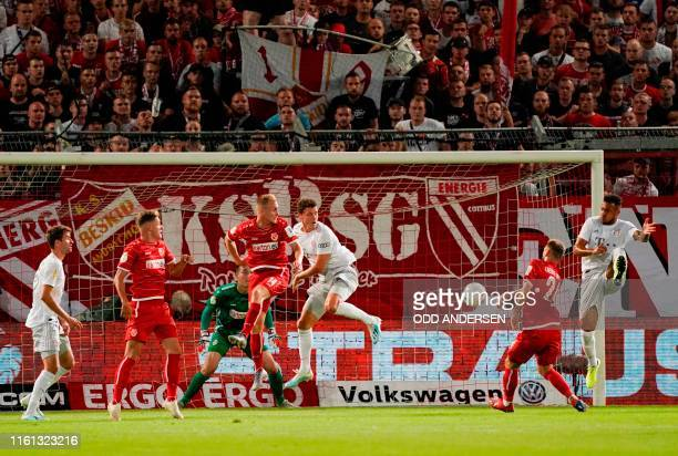 Cottbus' goalkeeper Lennart Moser makes a save during the German Cup first round football match FC Energie Cottbus v FC Bayern Munich at the...