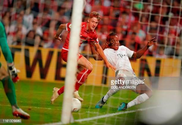 Cottbus' midfielder Tobias Eisenhuth and Bayern Munich's Portuguese midfielder Renato Sanches vie for the ball during the German Cup first round...