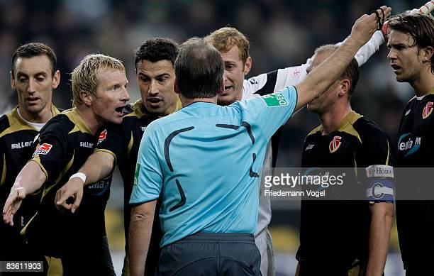 Cottbus players argue with the referee Lutz Wagner after he awarded a penalty to Wolfsburg during the Bundesliga match between VfL Wolfsburg and...