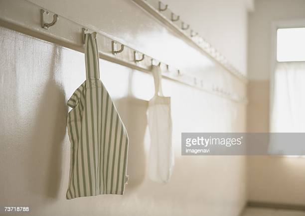 cotton bags hanging from hooks - トートバッグ ストックフォトと画像