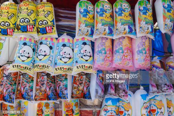Cotton candy being sold during the Iwakura Cherry Blossom Festival The highlight of the festival is long line of trees created by around 1400 cherry...