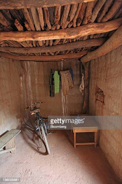 Cotton farmer Victorien Kamboule's bicycle stands in the room where his foster child Clarisse Kambiare sleeps on a plastic mat in Benvar Burkina Faso...