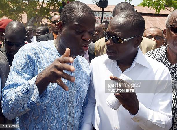Cotton maganate and leader of coalition of the opposition Patrice Talon talks with businessman Sebastien Ajavon after casting his ballot at Zongo...